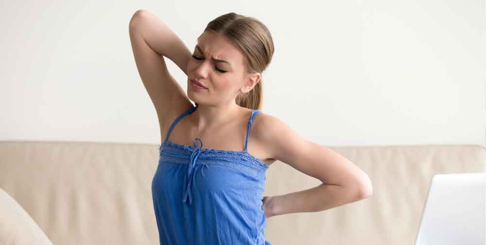 What can cause pain between shoulders?
