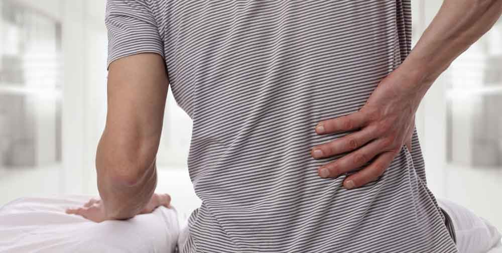 There are many reasons people can suffer from back pain. With that said the main reason is structural injury to the spine. Spinal muscle tone imbalance is at the root of most back pain issues. Whether pain is the result of muscle spasm, disc herniation, or postural faults most of it can be traced back to structural injury